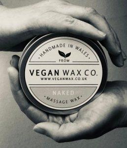 Hands holding Vegan Wax Co Massage Wax Pot